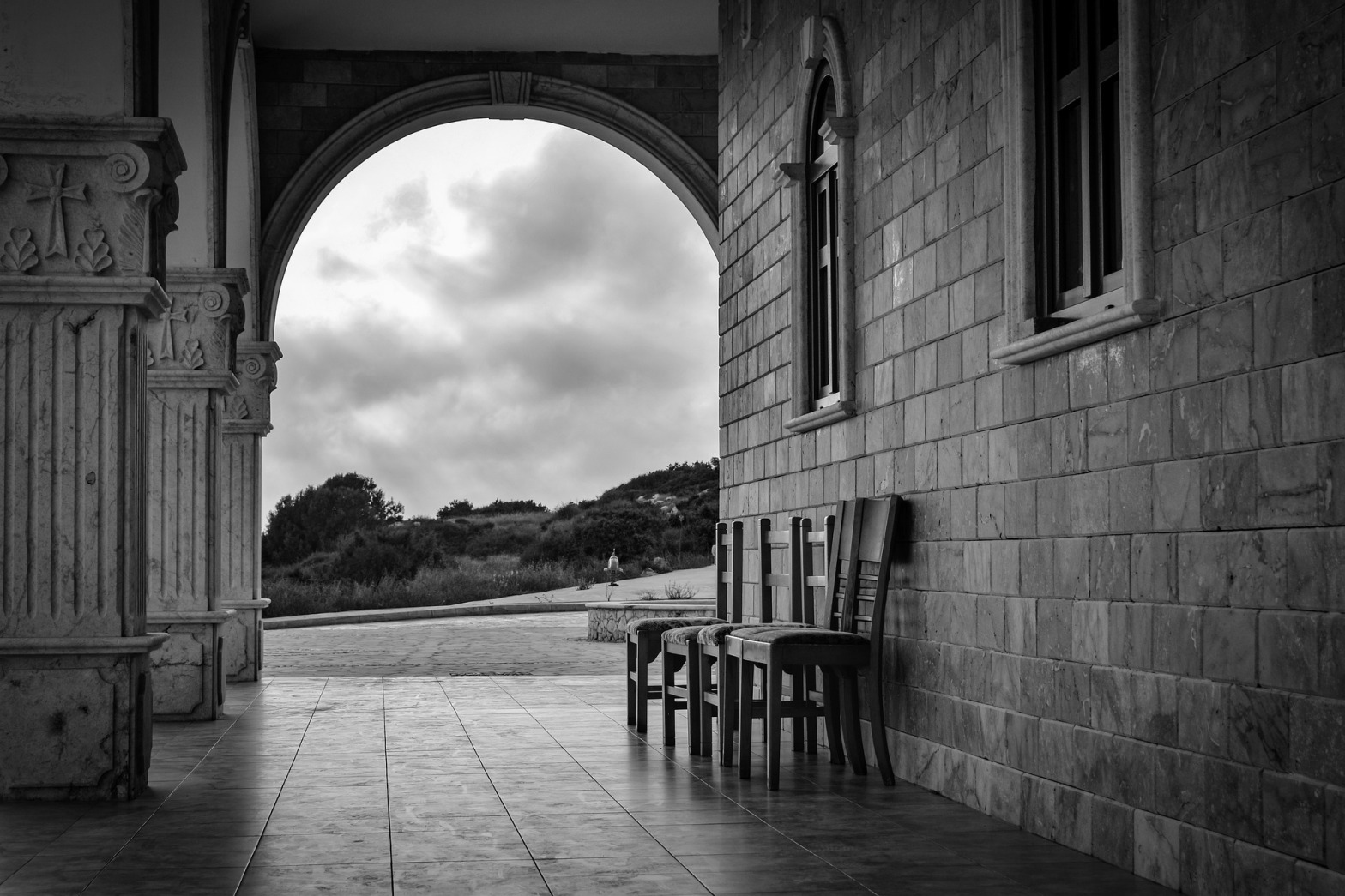 chairs outside church, black and white photo