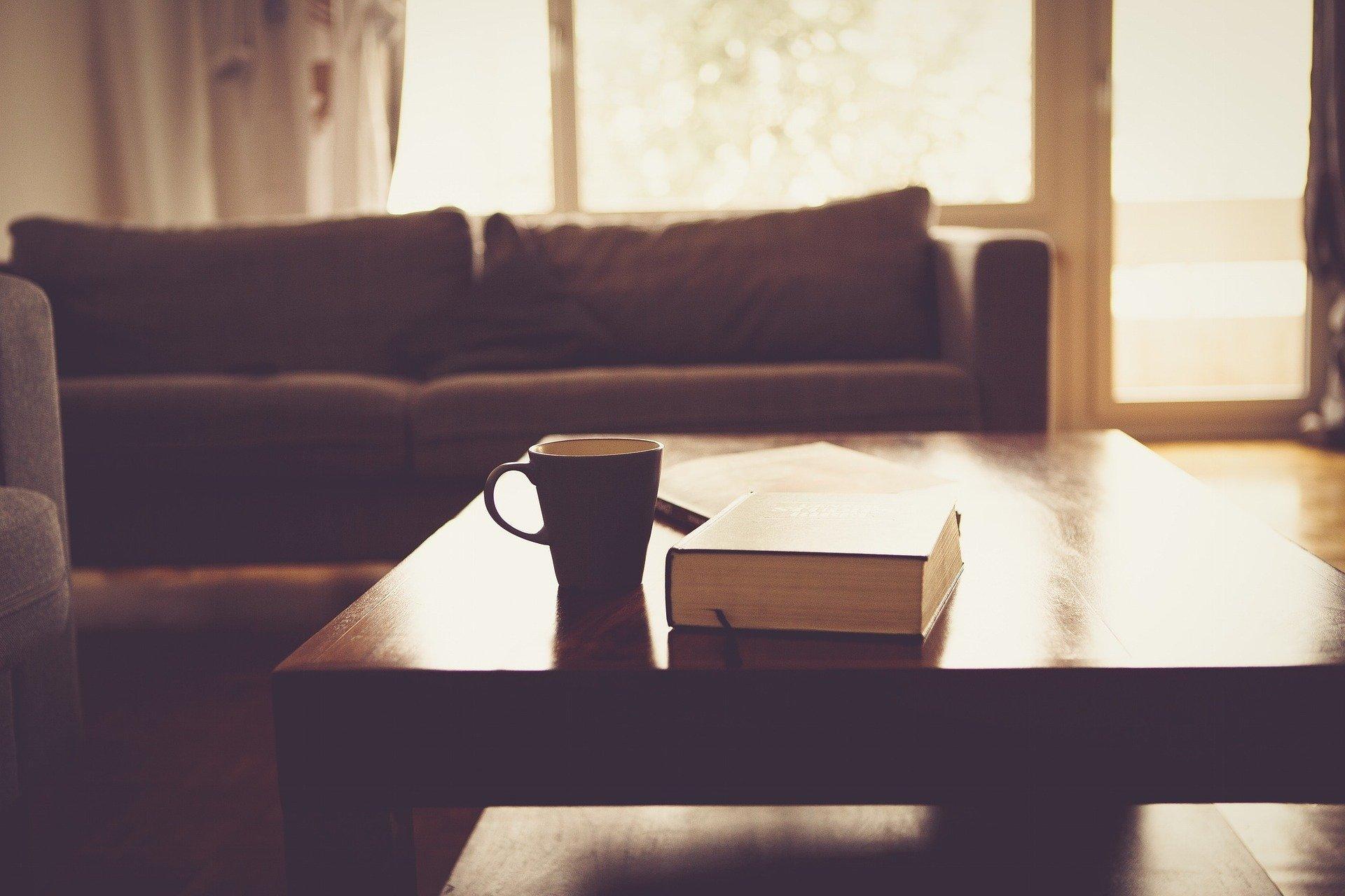 living room furniture, coffee mug and Bible on coffee table